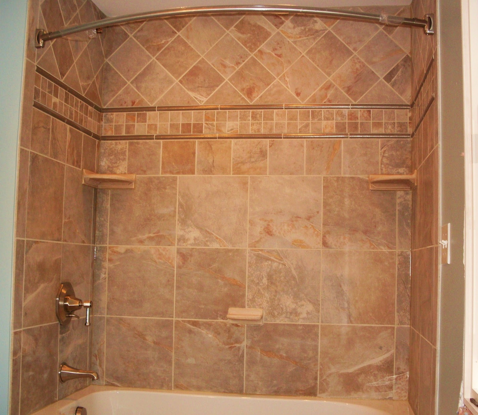 Kitchens baths by d 39 zyne june 2010 for Tile shower surround
