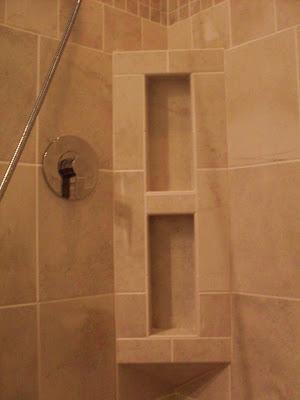 tan tile inside-corner niche for shampoo