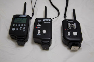 The Phottix Atlas (right) along with the PocketWizard MultiMax (left) & the Plus II (middle)