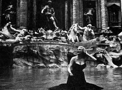 Anita Ekberg wading the Trevi Fountain