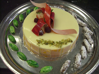 Pistachio dacquoise with white chocolate mousse and strawberry jelly.