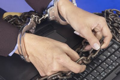 handcuffed computer user
