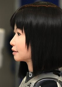 AP - A cybernetic human HRP-4C, designed to look like an average Japanese woman, appears during its demonstration in Tsukuba, near Tokyo, Monday, March 16, 2009. The humanoid robot, having a female face and black hair and trimmed down to 43 kilograms (95 pounds), makes a debut at a fashion show later this month.