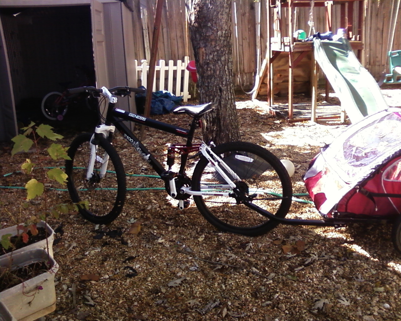 ... handlebars, stock grips, InStep child carrier hitch, and kick stand at