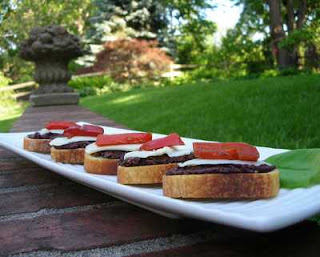 Olivada (tapenade) served on the patio