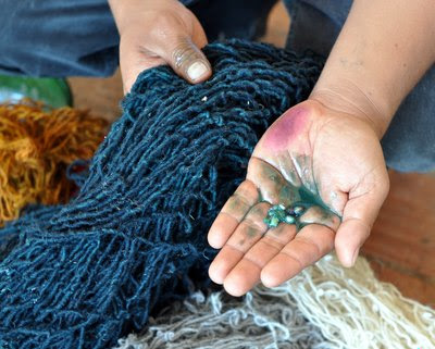 Rug maker from Oaxaca, Mexico mixes pomegranate with lime to dye a skein of yarn