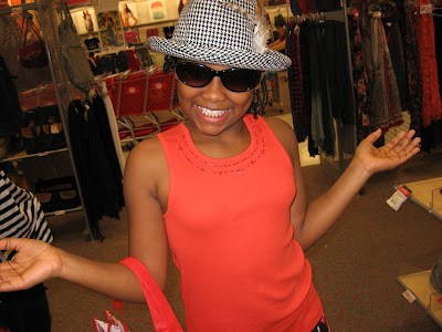 Eternity tries on hats during a shopping trip to Tar-jhay