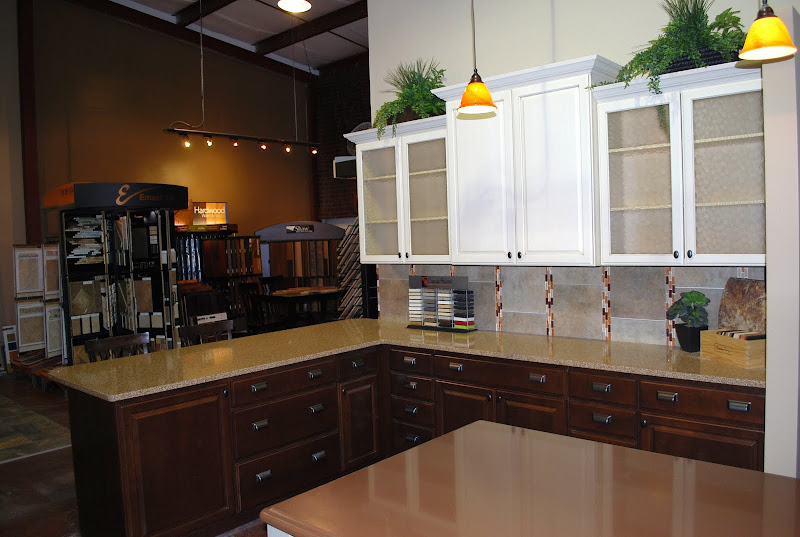 This kitchen display features colonial cream cabinetry, cappuccino title=