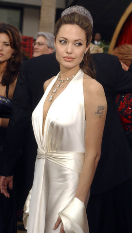 Beautiful Angelina Jolie showing her arm temporary dragon tattoo.