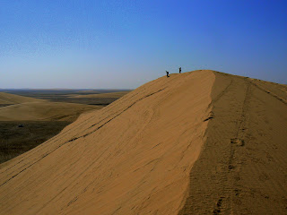 Running down a sand dune in the Qatar desert