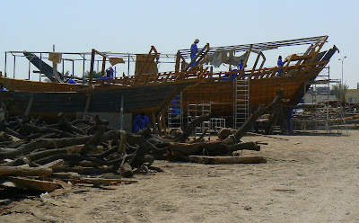 Men working on dhows
