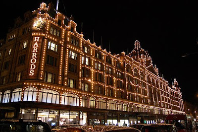 Harrods glows bright at night.