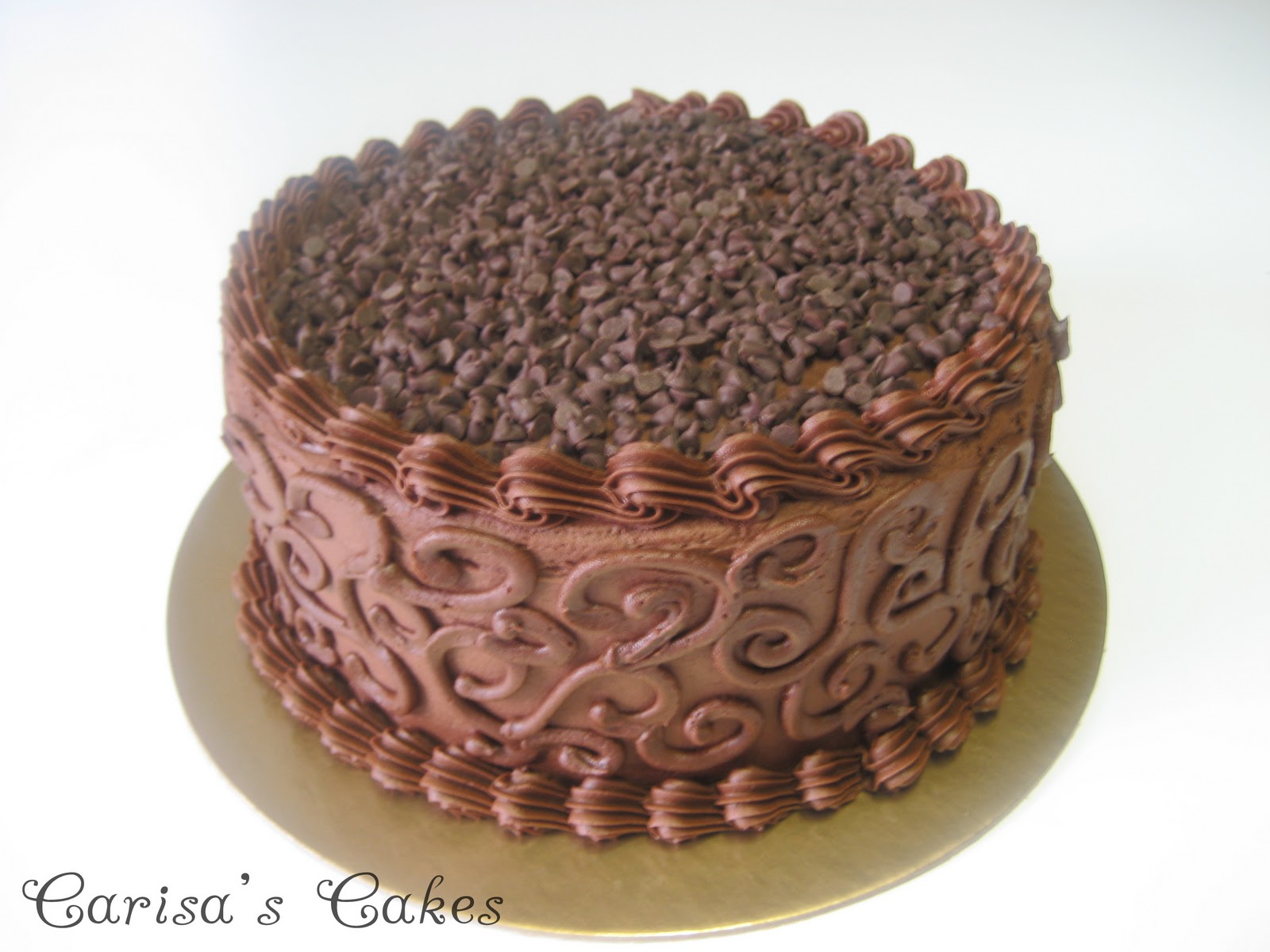 Double layer chocolate cake filled with chocolate, sprinkled with ...