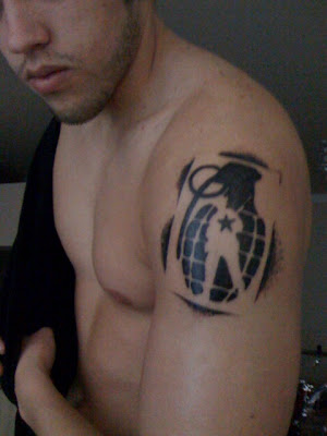 This guy also has a Grenade tattoo, except he doesn't snowboard. He is a UFC