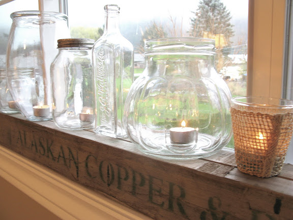 jar candle votives on pallet beam / White Trash Bedroom reveal with old door and gate headboard, via FunkyJunkInteriors.net