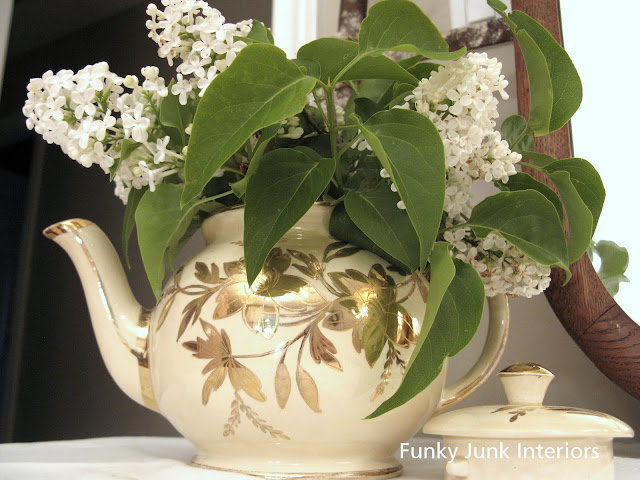 antique teapot for flowers / White Trash Bedroom reveal with old door and gate headboard, via FunkyJunkInteriors.net