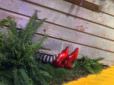 Wizard of Oz:  the witch's legs crushed under the house
