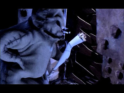 To distract Oogie Boogie, Sally suggestively places her leg around a corner