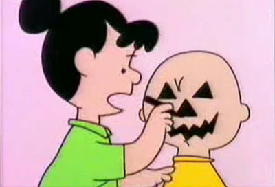 Violet uses Charlie Brown's head as a model for a jack o' lantern