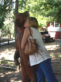 Cindy kissing wooden bear