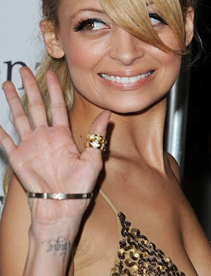 Tag : nicole richie tattoo, celebrity tattoo, nicole richie rosary tattoo