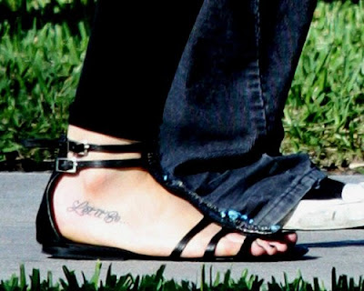 Rosary beads and cross tattoo on the ankle and foot. You can also look at