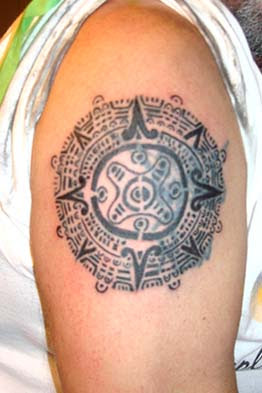 aztec tattoo sign on arms