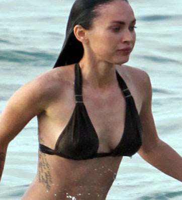 Megan fox new rib letter tattoo design