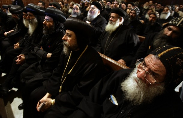[Followers+of+Pope+Shenouda+III,+the+ailing+head+of+Egypt's+Coptic+Orthodox+Church,+listen+to+his+weekly+sermon+in+the+main+cathedral+in+Cairo+December+30,+2009..jpg]