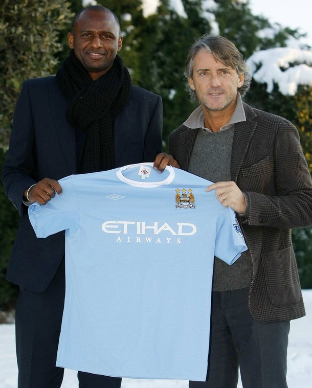 [Manchester+City's+new+signing+Patrick+Vieira+(L)+poses+with+manager+Roberto+Mancini+during+a+photocall+at+the+club's+Carrington+training+complex+in+Manchester,+northern+England,+January+8,+2010.jpg]