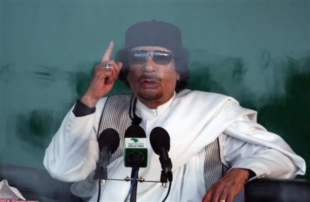 .سجل حضورك ... بصورة تعز عليك ... للبطل الشهيد القائد معمر القذافي - صفحة 12 Libyan+leader+Moammar+Gadhafi+delivers+a+speech+behind+bullet+proof+glass,+at+the+city+of+Benghazi,+Libya,+Thursday,+Feb.+25,+2010.+Libya%27s+leader+called+for+a+jihad,+or+holy+war,+against+Switzerland