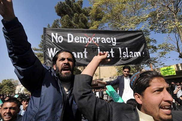 [Afghan+university+students+shout+anti-US+slogans+and+hold+a+banner+reading+'No+Democracy;+We+want+just+Islam!'+during+a+demonstration+in+Kabul.jpg]