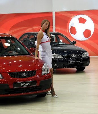 Slim Model in white dress like a red Car