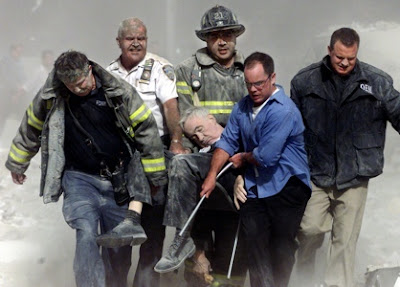 Father Judge's body being rescued from the wreckage by his firemen colleagues - Picture by Shannon Stapleton