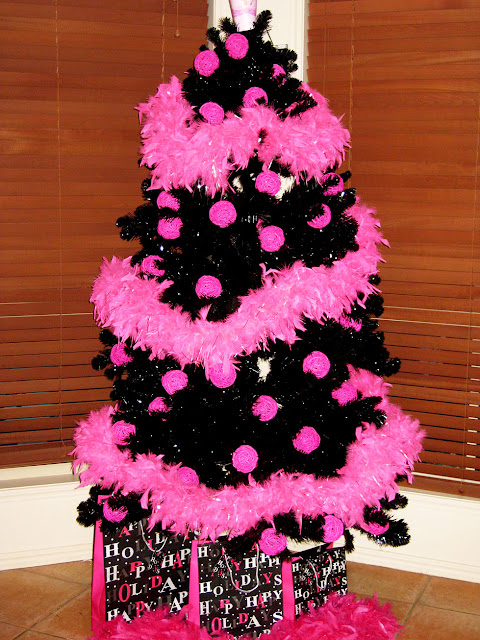 it is very basic with just hot pink cane balls and feather boas no lights so very quick to put up and away when we come home oh and of - Hot Pink Christmas Tree
