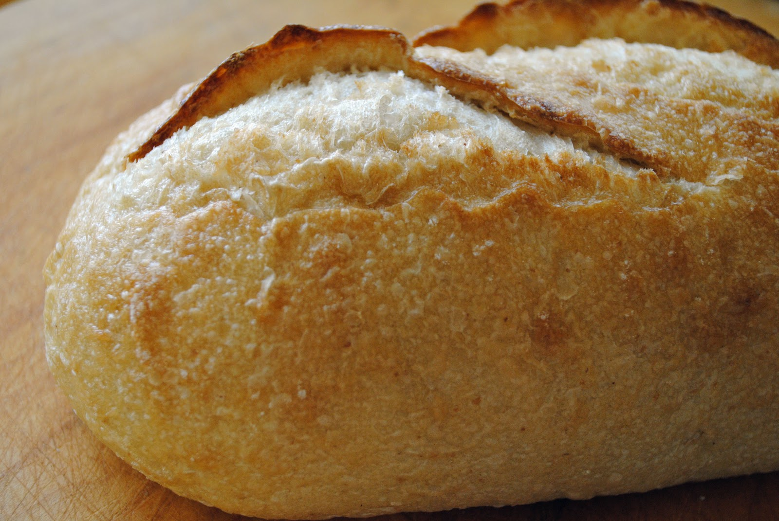 This is such a beautiful loaf of sour dough bread. There is an artisan ...