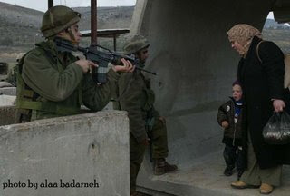 Israeli soldiers passing out candy to the kids