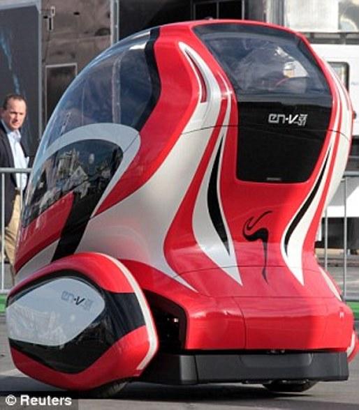 mobil masa depan tanpa sopir - Ramping, ramah lingkungan dan dapat berjalan sendiri: The EN-V berjalan dengan menggunakan tenaga baterai mampu melakukan perjalanan sekitar 25 mil dalam keadaan bermuatan, dengan kecepatan  puncak 25-mil per-jam