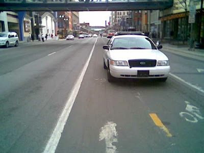 cop parked in bike lane