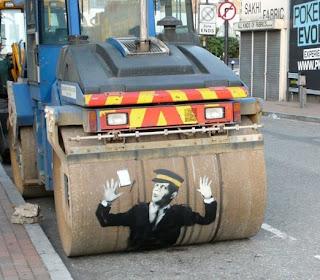 banksy traffic warden steamroller