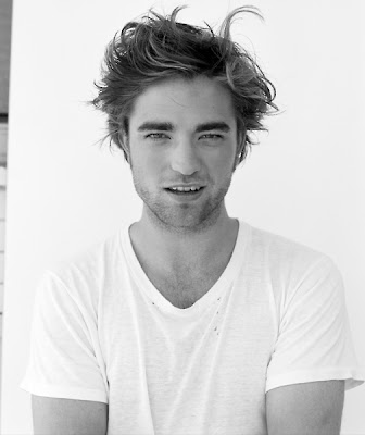 robert pattinson gq photo shoot. Robert Pattinson holding a