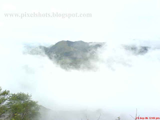 mountain valley covered in mist photograph from rajamala in munnar kerala state india,mist-in-munnar-photos,kerala-hill-station-sceneries