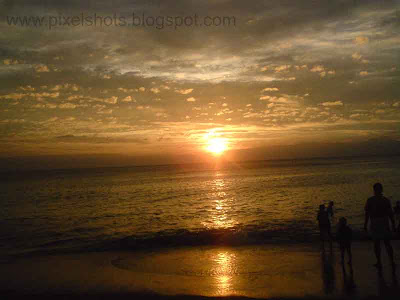 beach golden sunset with clouds in horizon from kerala