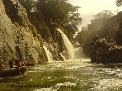 water falls in hogenekkal tamilnadu,india,photograph taken in a tour trip