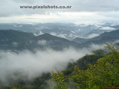 mountain ranges covered in mist in the valley a landscape scenery on the way to munnar hill station kerala