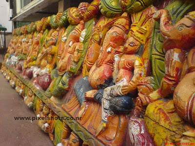 clay sculpture of ganesha the hindu god from sculpture and antiques shop in old jewstreet of cochin india kerala,clay sculptures,kaliman prathimakal,clay sculpture painting,sculptures for sale in cochin-kerala,street sculpture shop,ganesha and other gods