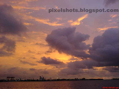 afterglow sunset horizon from kerala cochin,tropical sunset photographs,south indian sunsets,sky after sunset,beautiful evening sky with small clouds