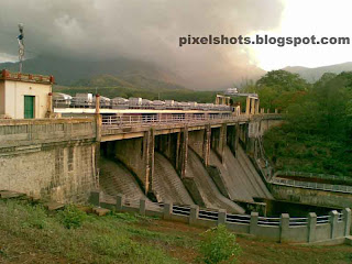 mangalam river dam irrigation project photograph from palakkad district of kerala india,photograph of the river dam spillway