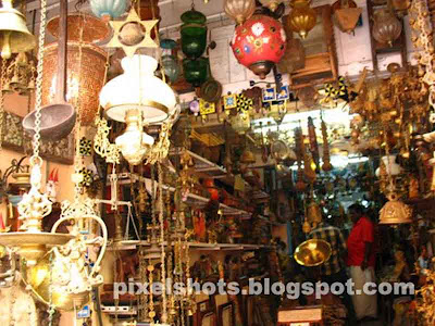 panchaloha sculptures,candlier lamps,decorative lamps,antiques pieces,shop selling sculptures and antiques,copper lamps,copper bell,oil brass lamps