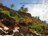varkala mountain cliffs,beach with mountain cliffs,unique kerala beach,arabian sea beaches,mountain cliffs and rocks of varkala beach landscapes,geographical monument,varkala formations,beach sedimentary rocks